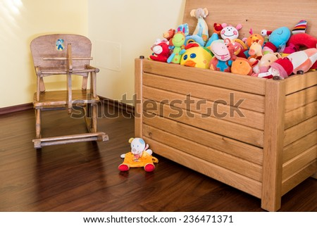 Wooden horse and Soft toy in a child's bedroom - stock photo