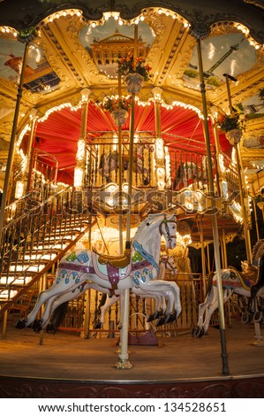 Wooden horse on an old-fashioned merry-go-round in Paris, France