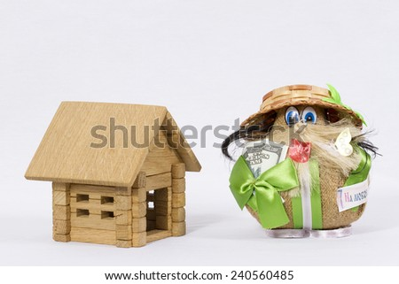 Wooden house and the house on white background/ Wooden house and amulet - stock photo