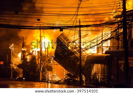 Wooden house burning.fire - stock photo