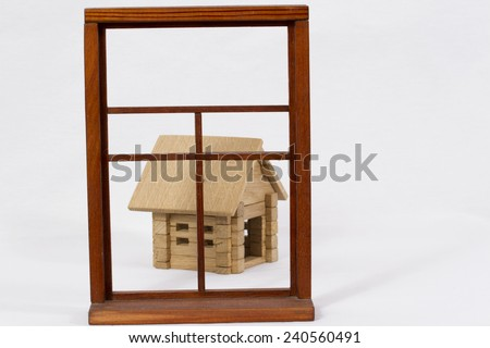 Wooden house in a wooden box/ Wooden house and wooden box - stock photo