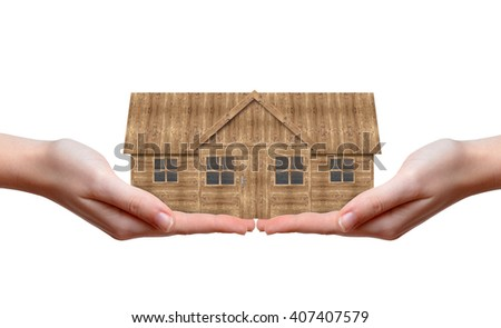 Wooden house in hands isolated on white background - stock photo