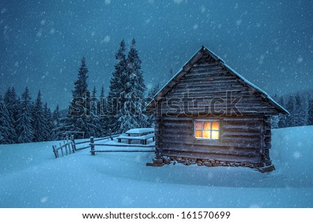 wooden house in winter forest - stock photo