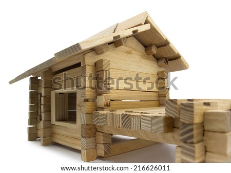 Wooden house. Isolated wooden toy house close view.