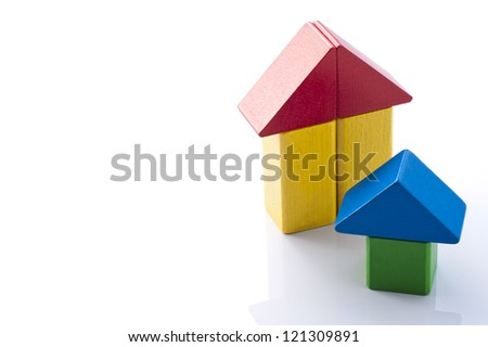 Wooden house made of colorful building blocks