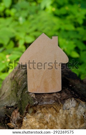 wooden house on a background of nature, handmade