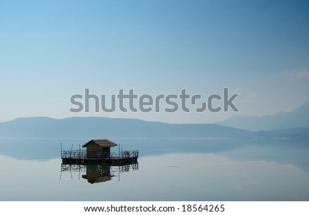 Wooden house silhouette, Prespa Macedonia (place for text)
