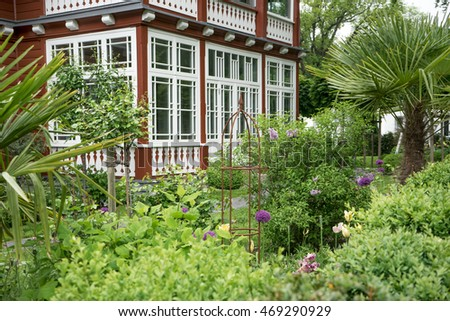 Wooden house with beautiful garden / garden / wooden house