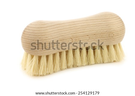 wooden household brush on a white background - stock photo