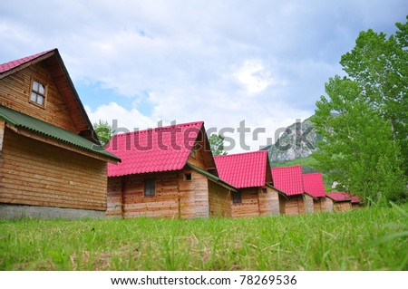 wooden houses at nature - stock photo