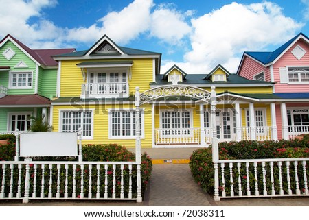 Wooden houses painted in Caribbean  colors in Samana resort, Dominican Republic - stock photo