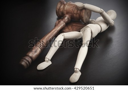 Wooden Human Figurine Pulling Judges or Auctioneers Hammer, Trial Or Auction Concept - stock photo