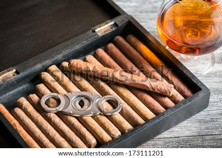 Wooden humidor full of cigars - stock photo