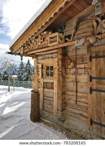 wooden hut in the alps in the mountains with snow