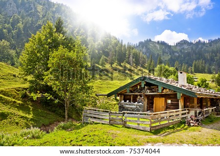 Wooden hut in the mountains - stock photo