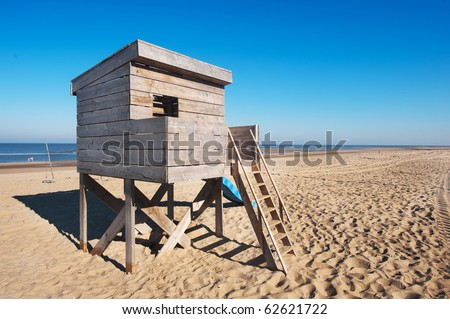 Wooden hut on poles at the beach - stock photo