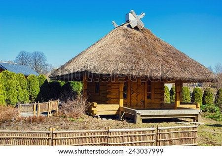 Wooden Hut With Thatched Roof. Riga, Latvia - stock photo