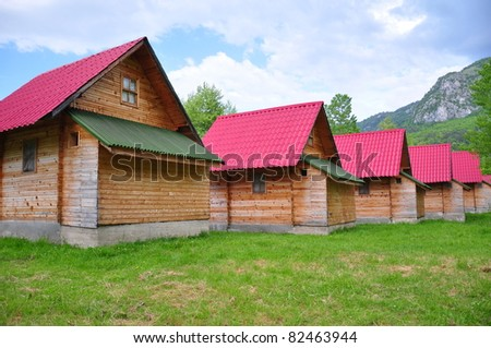 wooden huts with red roofs - stock photo