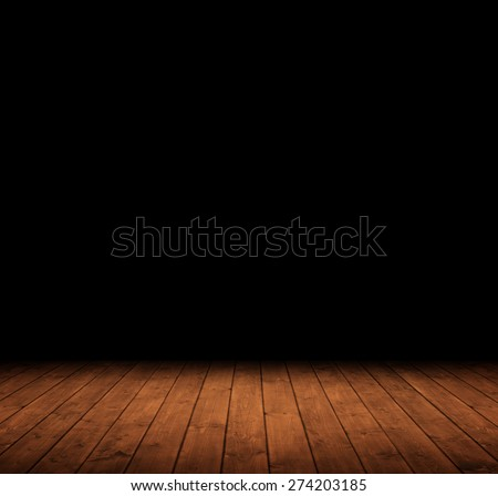 wooden interior room leading into the dark. - stock photo