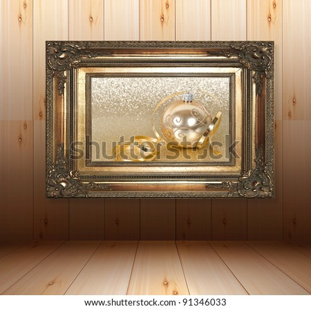 wooden interior with golden frame. golden christmas ball with streamer over golden shiny background. christmas gallery - stock photo
