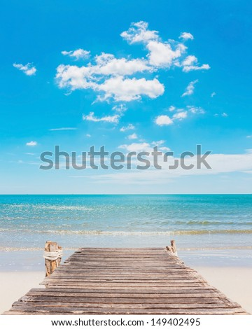 Wooden jetty and beauty beach in Thailand - stock photo
