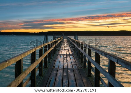 Wooden jetty at Lake Ammersee, Buch, Bavaria, Germany - stock photo