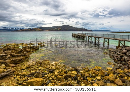 Wooden Jetty in Dennes Point, North Bruny Island, Tasmania, Australia. Bruny Island is located along the southeast coast of Tasmania, which is separated from dentrecasteaux Channel - stock photo