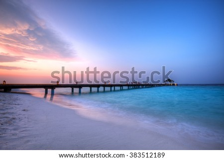Wooden jetty in sunset  - stock photo