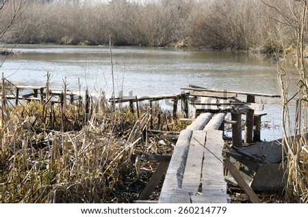 Wooden jetty, lake pier, wooden dock, old wooden mooring - stock photo