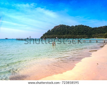 Wooden jetty on beach on exotic Ko Kut island leading into the ocean in tropical Thailand