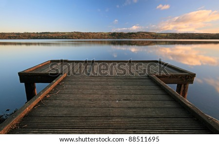 Wooden jetty on Castle semple Loch as the Sun was setting