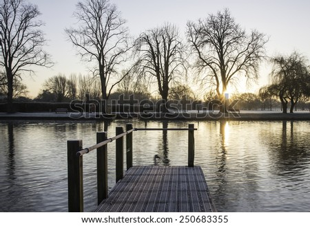 Wooden jetty on the River Avon - stock photo