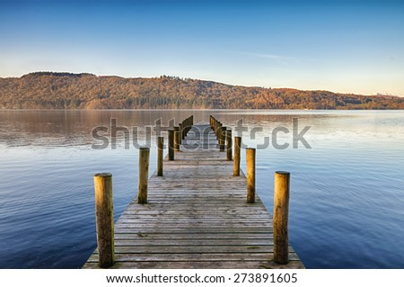 Wooden jetty on Windermere. - stock photo