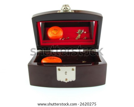 Wooden jewel box with a mirror showing its contents, isolated on white. - stock photo