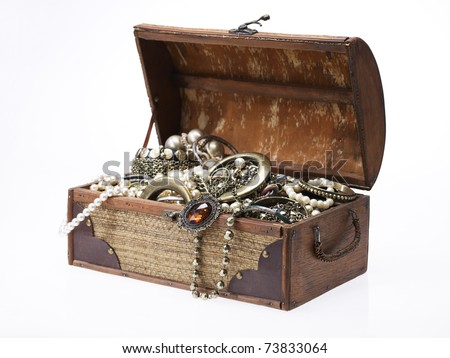 wooden jewellery box  packed with accessories - stock photo