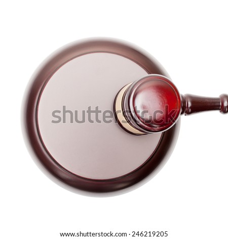 Wooden judge gavel above sound box - view from top - stock photo