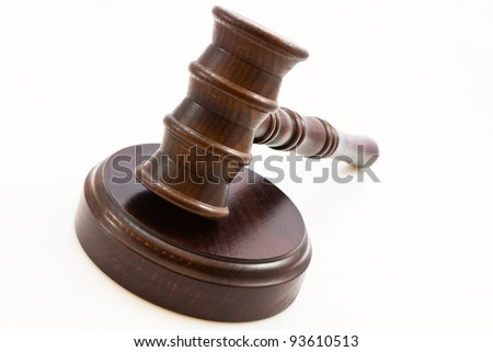 wooden judge gavel and wooden stand on a white background