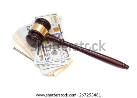 Wooden judge gavel on American money  - stock photo