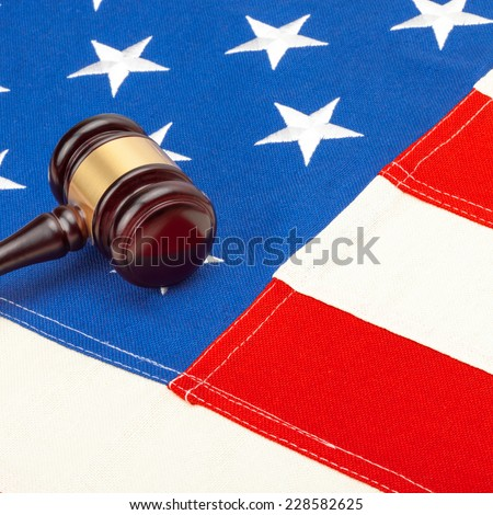 Wooden judge gavel over USA flag - stock photo