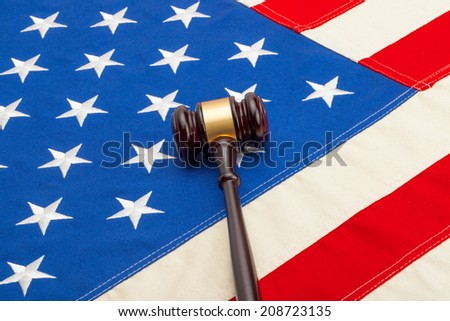 Wooden judge gavel over USA flag - studio shoot - stock photo