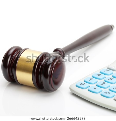 Wooden judge's gavel and calculator close to it - close up studio shot - stock photo