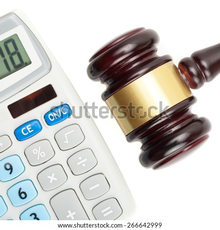Wooden judge's gavel and calculator - close up studio shot over white - stock photo