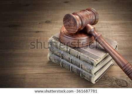 Wooden Judges Gavel And Old Law Books On The Rough Wooden Table In The Background. Law Concept. Top View - stock photo