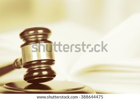 Wooden judges gavel, close up. Retro stylization - stock photo