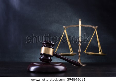 Wooden Judges gavel ,golden scales justice with black background. - stock photo