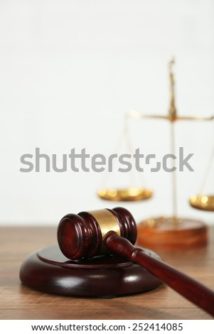 Wooden judges gavel on wooden table, close up - stock photo