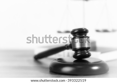 Wooden judges gavel on wooden table, close up. Retro stylization - stock photo