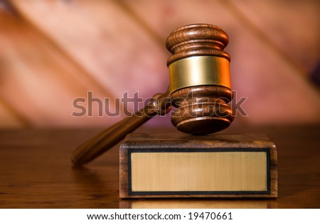 Wooden justice gavel and block with brass - stock photo