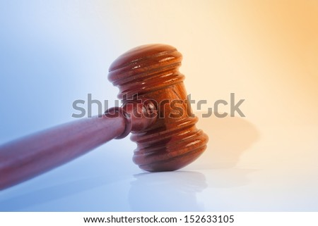 Wooden justice gavel on abstract background. - stock photo