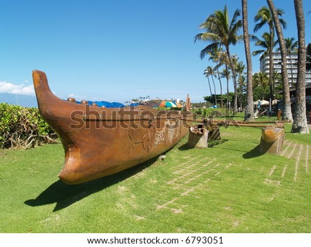 wooden kayak on a beach - stock photo